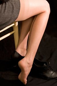 100% nylon, these stockings hearken back to old-fashioned nylons, with a welt at the cuff and classic backseams. Heel and toe are reinforced with a semi-sheer Cuban heel. Feather-light and ultra-fancy, they're perfect dress up stockings.  Please note that these stockings do not include the tattoo patterns you see in some of the images...we just wanted to show you how truly sheer these are.