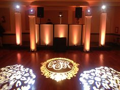Our setup for the Foster wedding @ the Brooklake. Diamond lighting towers, LED uplights, custom monogram and DJ facade.