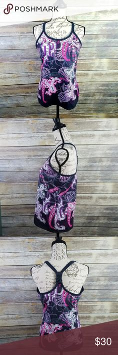 ATHLETA Paisley Pavitra Athletic Tank Top with Bra ATHLETA Paisley Pavitra Athletic Tank Top with Bra  Super cute paisley design with grays, pinks, and purples. Style Number #222002. Lots of stretch and an unpadded shelf bra. The back features a knotted racerback. Measures about 17.5 inches pit to pit and is about 25 inches long.  Thank you for looking and please check out my closet!  C18 Athleta Tops Tank Tops