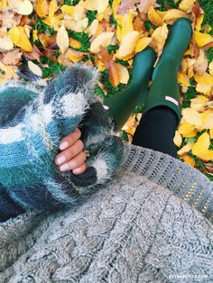 green hunter boots sweater rainy day outfit