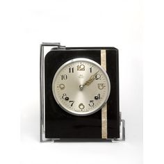 This Art Deco-style clock was made in Shanghai, the most fashionable Chinese city in the 1930s, and also the most technologically advanced. It is not known if B.E. Co. was a foreign firm trading in China. The consumer would have been either a Chinese eager to adopt a western life style, or a Westerner living in China at that time.