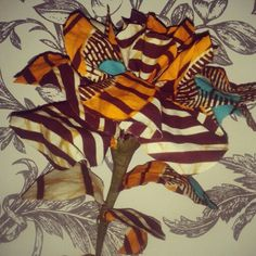 "Handmade cattleya (orchid) flower, using Vlisco ""ankara"" fabric. Perfect as a single or amassed in a vase.  Contact me for bespoke creatives"