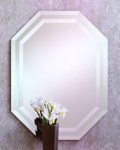 321 – Octagon Frameless Mirror features a mirror-on-mirror with 1″ beveled edges.20″ wide, 28″ high and 1/2″ deep