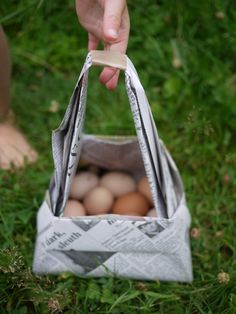 make a newspaper basket - fun with the girls -- We could collect things on a nature walk afterward.  Wonder how many rocks this will hold.  Knowing my daughters that's what they want to fill it with.