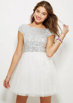 It's the party dress we all totally adore for every dance, prom, Homecoming and party. Capsleeve with allover sequin bodice and kick-out tulle skirt. Just enough sparkle for your big night!