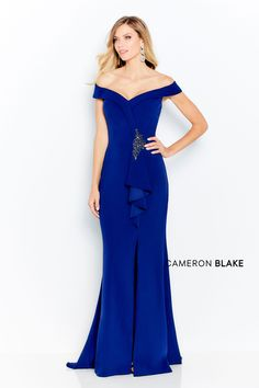 Cameron Blake Style 120614. Description: Off-the-shoulder novelty stretch sheath, folded V-neckline and back, natural waistline with beaded motif over cascading ruffle that opens to a slit, slim skirt with a sweep train. Matching novelty stretch shawl included. Details: Length: Long;Waistline: Natural;Neckline: Off the Shoulder, V-Neck;Silhouette: Sheath;Fabric: Beading, Novelty Stretch;Special Features: Shawl Included;Sleeve Type: Off the Shoulder Cameron Blake, Terani Couture, Column Dress, Perfect Prom Dress, Mermaid Skirt, Prom Dresses Online, Two Piece Dress, Stretch Dress, Fitted Bodice