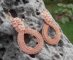This new set of earrings are made out of natural copper jewellery wire by intricate weaving technique. They hang really nicely and the swirls on the top give them a little bit of an Egyptian style.. Price is 40$ (+4$ S/H if mailed). For more designs please visit www.facebook.com/petra.leblanc