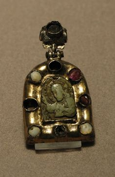 'Pendant: Christ Blessing' (12th or 13th century), framed with soapstone, gilded silver, pearls, red glass and rubies from the Byzantine empire, height 5.6 cm (2 in) and width 3.1 cm (1 in), located at Department of Decorative Arts, Richelieu, First Floor, Room 1, Louvre Museum, Paris, France. Credit: Gift of Mrs. N. Landau (1983).