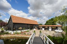 Our beautifully restored Essex Barn dating back to The Stable Courtyard is where reception drinks take place using our rustic stable bar. Stables Bar, Gypsophila Wedding, Tin Shed, Indoor Ceremony, Marquee Wedding, Real Weddings, Barn Weddings, Wedding Flower Arrangements, Bride Bouquets