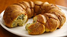 Little spinach and cheese filled pastry balls are baked together and inverted on a plate for a foolproof appetizer idea perfect for any party.