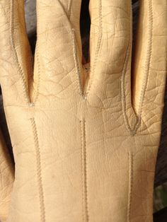 c1810 leather buff-coloured long gloves. Detail.