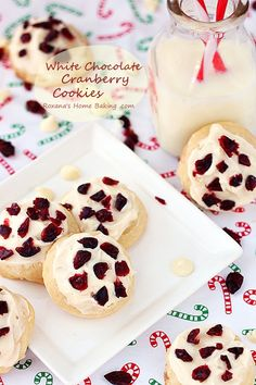 A soft and light butter cookies with white chocolate chips hidden inside them. Frosted with buttercream and sprinkled with dried cranberries to put everyone in the holiday spirit roxanashomebaking.com #25recipestoXmas