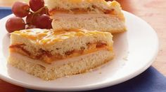 "Join the club and make ""TCBs"" a family favorite. Baked turkey, bacon and cheddar sandwiches"