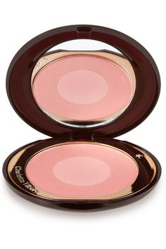 Charlotte Tilbury's Cheek To Chic in Love Glow has a bit of golden shimmer. For my taste this powder blush has a bit too much shimmer in it. I find you have to be very careful not to over-apply it because one certainly doesn't want to look like a disco ball. I'm also afraid to use it on bad skin days because the last thing you want to do is put shimmer on concealed blemishes, which will accentuate them. The colour is beautiful though.