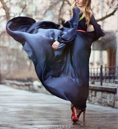 This shot is more about my love of photography than the outfit and model. It's actually hard to get really clear idea of the cut of the dress, but the flowing and billowing of the dress brings such vitality and life into a shot that would otherwise have been a typical Parisian fashion still.