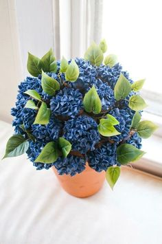 I've seen a few Cupcake Bouquet tutorials on Pinterest and, although this is not a tutorial, just a picture, this is mine that I did. I combined two pins - the bouquet idea and a pin I made from a hydrangea tutorial I found online.