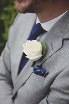 This whole ensemble Boutonniere Ideas for the Groom - a little differe - Boutonniere Ideas for the Groom - a little different with the Grey Suit and Midnight Navy Blue accesories Repinly Weddings Popular Pins