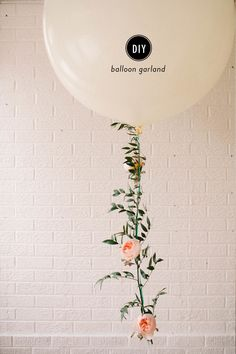 Photography: Michele Hart Photography - www.michelehartphotography.com  Read More: http://www.stylemepretty.com/living/2015/06/03/diy-floral-balloon-garland/