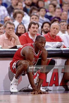 Michael Jordan #23 of the Chicago Bulls sits at the scorers table against the Portland Trail Blazers during a game played circa 1989 at the Veterans Memorial Coliseum in Portland, Oregon.