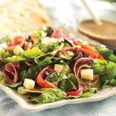 Romaine lettuce, roasted peppers, salami, and cheese are tossed with a zingy homemade vinaigrette.