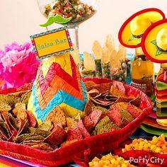 Fun salsa bar idea: Serve tortilla chips in a sombrero piñata! Click for more Cinco de Mayo party ideas!