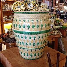 Decorative Italian Ceramic Urn with Green & Yellow Scales - This decorative handmade and hand painted Italian pottery urn from Florence is patterned with a traditional Italian scale-like pattern. Its bright colors and unusual shape make this piece a unique addition to any style of decor. Found at the Italian Pottery Outlet in Santa Barbara, CA