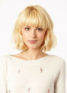 Blunt, straight bangs and textured body is makes for a classic look with a casual, cute bob!