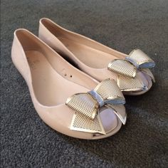 Gold Bow Peep Toe Flat! Never worn. Tan color flat with a gold bow on the peep toe front. Shoes Flats & Loafers