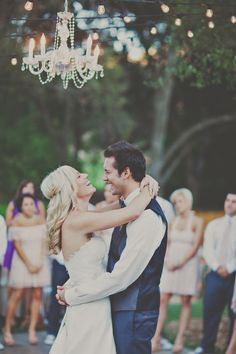 Love that chandelier  hairdo  DIY Rustic Sunflower Wedding | Teal Photography | Bridal Musings