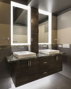 Photo Gallery For Website Soft Strip elegantly illuminates this mirror and vanity bathroom duo to create a serene atmosphere while allowing for ample light to apply make up