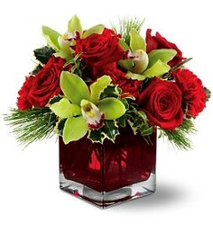 Teleflora's Rose Chic - Great for Christmas Wedding/Quinceanera table decor. Can find it in AbileneTX at Baack's Florist & Greenhouses