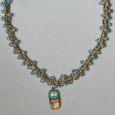 I love the idea of making a bracelet and necklace set with a crochet needle and some beautiful beads!