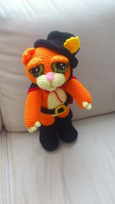 In Spanish. Hopefully Google translate will work well enough to read.  Amigurumi Puss in Boots - FREE Crochet Pattern / Tutorial