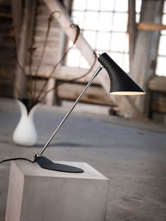 This modern table lamp features a chrome arm and an adjustable black shade #office #work