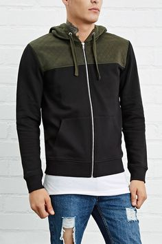 A knit hoodie with a zippered front, long sleeves, a contrast quilted yoke and drawstring hood, and split kangaroo pockets.