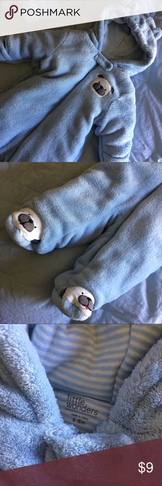 • Winter Onsie Light blue winter onesie, very thick and warm with zipper and hoodie with little ears. Has puppy on toes, the back is just blue. Only worn very few times, it's like new. One Pieces