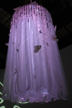 Custom hand made white sheer ribbon chandeliers were created and intricately accented with opal butterflies.