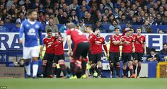 Ander Herrera celebrates with team-mates after scoring his side's second goal