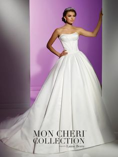 Strapless soft silk crepe wedding ball gown with mitered corset bodice, covered buttons cascade down back bodice to hem, full box pleated skirt with chapel length train, detachable halter and spaghetti straps included. Custom colors are also available. Sizes: 0 – 16 Colors: Ivory, Red