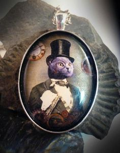 """Mr Blue - Resin covered portrait of 'Mr Blue', original artwork by The Clockwork Jewel. Set in a silver plated bezel on a chain, length  - 18"""" - 20"""". Size - 4cm x 3cm. Price - £17.99"""