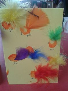 Thumb print Easter chicks with feathers