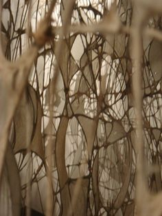 Detail, 'The Fragility of (Dis)Connectedness' by American artist Kirstin Demer. Basket reed, flax and abaca paper. via the artist's site