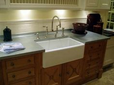 Zinc countertop and a farmhouse apron front sink-love it!  DON'T love the oak cabinets, though...