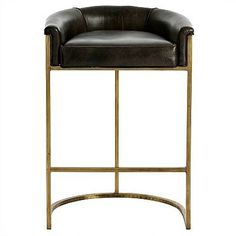 Arteriors Home presents a new version of their ever-popular Calvin bar stools. Dropping the back and arm height, this updated Calvin Brindle Bar Stool can easily slide under the bar top to provide more room when not in use in the kitchen or the bar. The top grain, brindle-colored leather upholstery combines beautifully with the modern antique brass frame.
