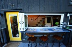 Pass-thru window with fold-out table and panoramic opening for the tiny home.