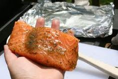 salmon on BBQ in foil boat with lemon and pesto!   BBQ it all together and enjoy