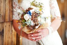 Rustic winter bouquet with pinecones, fabric flowers, brooches, and burlap | Photo by AK Studio & Design