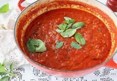 The best authentic Italian Marinara Sauce with Basil and Garlic in a Red Pot.