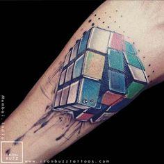 3D Rubix cube by Eric Jason Dsouza #InkedMagazine #rubixcube #3D #realistic #tattoo #tattoos #inked #ink