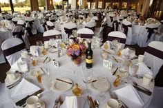 A glamorous #fallwedding with brown-sash accented chairs and autumn inspired floral centerpieces #terryhills #wnywedding